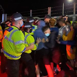 Police clash with protesters over asylum seekers being housed in Wales
