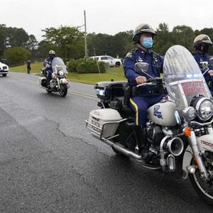 Trooper quietly buried amid scrutiny over Black man's death