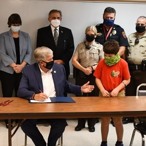 Mike Parson the hypocrite? Photos of Parson's unmasked signing in Carthage nowhere to be found on his photo page